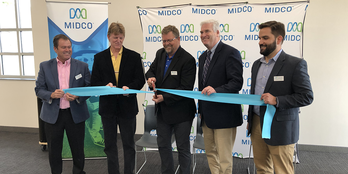 Ribbon cutting at press conference announcing Midco GIG Internet in St. Joseph, MN